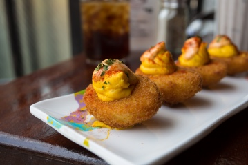Fried Deviled Eggs with a Bacon Bit flavored batter at Crazy Annies in Washington Heights